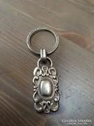Fossil márkájú ezüstözött kulcstartó
