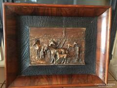 Falikép bronzból