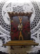 Buddhista házioltár Szent Teréz szobrocskávbal