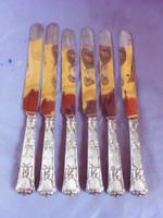 6 db ezüst kés dobozában.